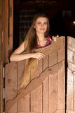 Pretty long hair Cowgirl standing in saloon entrance Royalty Free Stock Photography