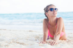 Pretty long haired woman enjoying her time at white sand beach Royalty Free Stock Photos