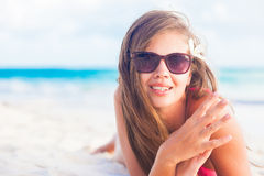 Pretty long haired woman enjoying her time at white sand beach Stock Image
