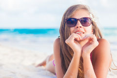 Pretty long haired woman enjoying her time at white sand beach Stock Photo