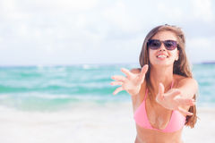 Pretty long haired woman enjoying her time at white sand beach Royalty Free Stock Images