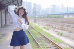 Pure and lovely Asian girl. Pretty lovely girl and rail background. A slightly retro portrait. Play on the rails royalty free stock photography