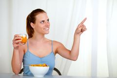 Pretty lovely woman eating meal and pointing Stock Photo