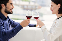 Pretty lovers drinking wine while celebration stock photo