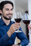 Pretty loving couple drinking wine stock images
