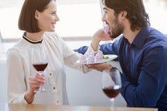 Pretty loving couple enjoying sweet food royalty free stock photography