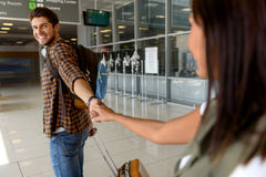 Pretty loving couple separating before flight stock images