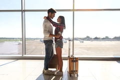 Pretty loving couple waiting for flight Stock Photography