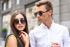 Pretty loving couple walking in town stock images