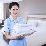 Pretty maid hotel with towels Stock Photo