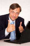Pretty man at computer Royalty Free Stock Photos