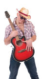 Pretty man with cowboy hat. And guitar on white background Royalty Free Stock Photography