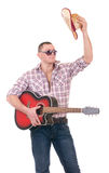 Pretty man with cowboy hat and guitar. On white background Royalty Free Stock Photo