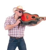 Pretty man with cowboy hat and guitar. On white background Stock Photography