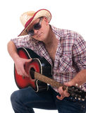 Pretty man with cowboy hat and guitar. On white background Royalty Free Stock Photography