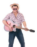 Pretty man with cowboy hat and guitar. On white background Stock Photo