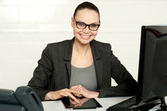 Pretty manager working on wireless tablet device Stock Photo