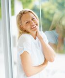 Pretty mature blond enjoying in her white dress Stock Photo