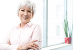 Pretty mature business woman smiling confidently Royalty Free Stock Photo