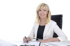Pretty mature business woman smiling on office desk Stock Images
