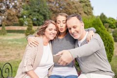 Pretty mature family is photographing themselves royalty free stock photography