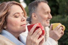 Pretty Mature Husband And Wife Are Resting In Park Stock Photo