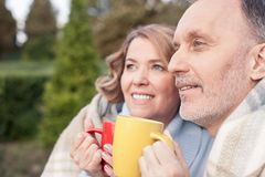 Pretty mature husband and wife are warming with Stock Images