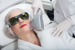 Pretty mature lady is getting cavitation treatment Stock Photography