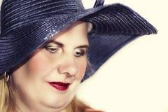 Pretty mature woman in a hat Stock Photo