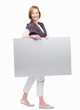 Pretty mature woman holding a blank board on white Royalty Free Stock Image