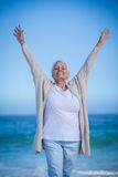 Pretty mature woman raising her arms Royalty Free Stock Photos