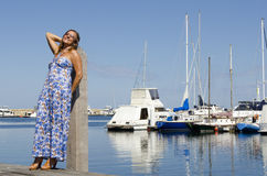 Pretty mature woman relaxing at marina Royalty Free Stock Image