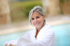 Pretty mature woman relaxing in spa hotel Royalty Free Stock Photos
