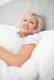 Pretty mature woman resting in bed Royalty Free Stock Photography