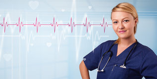 Pretty medical doktor listening to red pulse and heart rates Royalty Free Stock Photo