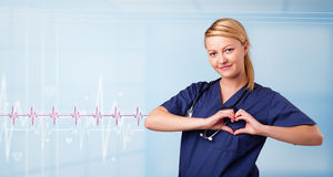 Pretty medical doktor listening to red pulse and heart rates Stock Images