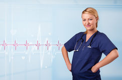 Pretty medical doktor listening to red pulse and heart rates Royalty Free Stock Images