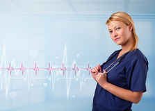 Pretty medical doktor listening to red pulse and heart rates Stock Photo