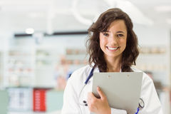 Pretty medical student smiling at camera Royalty Free Stock Images