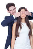 Man covering woman eyes Royalty Free Stock Photos