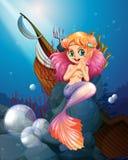 A pretty mermaid under the sea near the rocks. Illustration of a pretty mermaid under the sea near the rocks Royalty Free Stock Photography