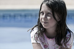 Pretty but Messy Brown Haired Girl by the Pool stock photos