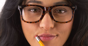 Pretty Mexican woman wearing glasses Royalty Free Stock Photography