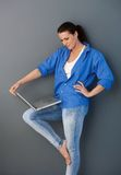 Pretty mid-adult woman with laptop Stock Photo