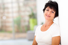 Pretty mid age woman. Relaxing at home royalty free stock image