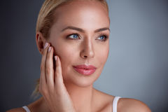 Pretty middle age woman with perfect skin Stock Photography