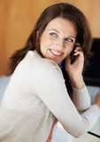 Pretty middle aged brunette using cellphone Royalty Free Stock Photos