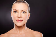 Middle aged beauty. Pretty middle aged woman beauty on black background Royalty Free Stock Photo