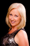 Pretty middle-aged woman dressed for party Royalty Free Stock Photography