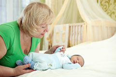Pretty middle-aged woman and her newborn grandson Stock Photography